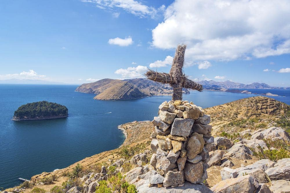 Cross On A Hill With Lake Titicaca In The Background Taken From Isla Del Sol In Bolivia