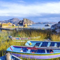 Colorful Boats Near Floating Islands On Lake Titicaca Near Copacabana, Bolivia