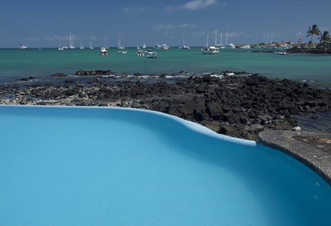 Blue Pool, Crystal Clear Ocean Waters And Boats Docked At Puerto Ayora, Santa Cruz Island,Galapagos Archipelago, Ecuador , South America