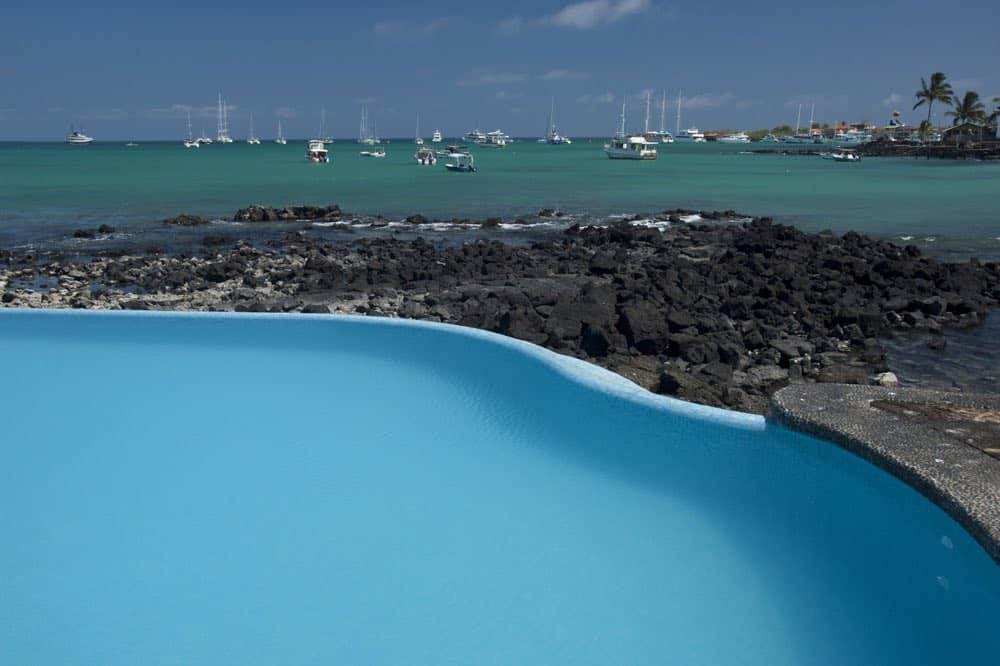 Blue Pool, Crystal Clear Ocean Waters And Boats Docked At Puerto Ayora, Santa Cruz Island,Galapagos Archipelago, Ecuador , South America